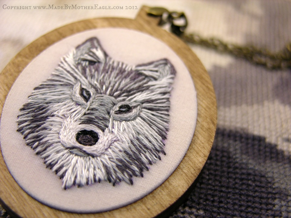 embroidered wolf pendant