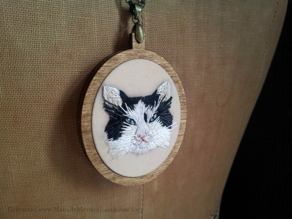 miniature embroidered cat portrait pendant