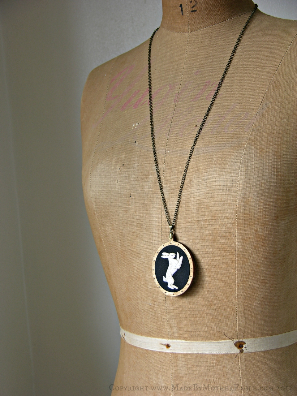 embroidered hare pendant