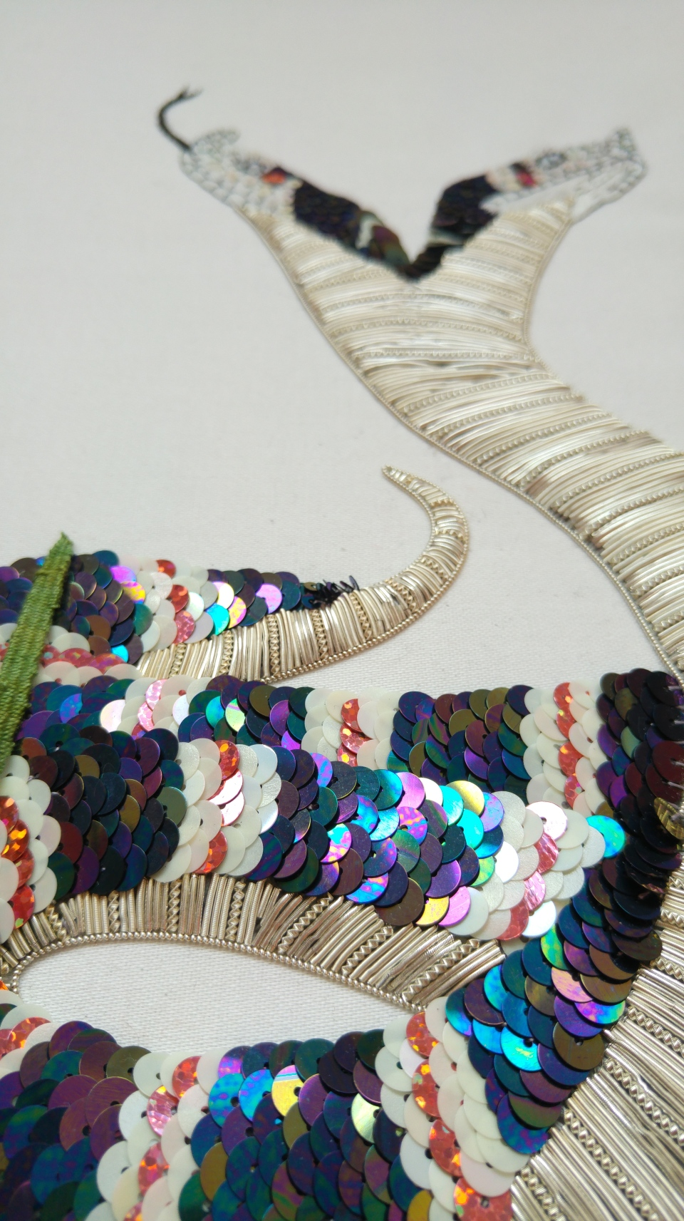 sequinned snake embroidery